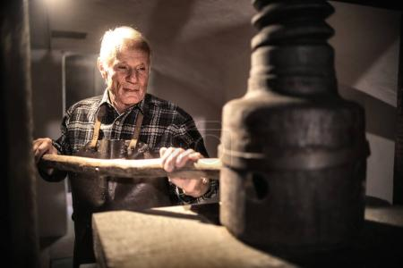 Aged artisan at work in a laboratory