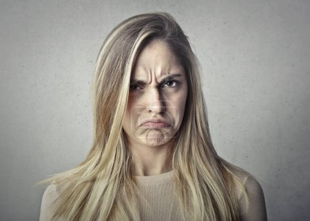 Photo for Blond girl with an angry expression - Royalty Free Image