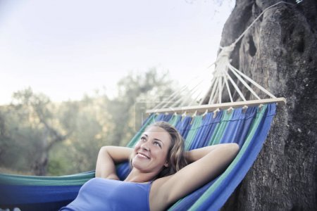Relaxed girl on a hammock
