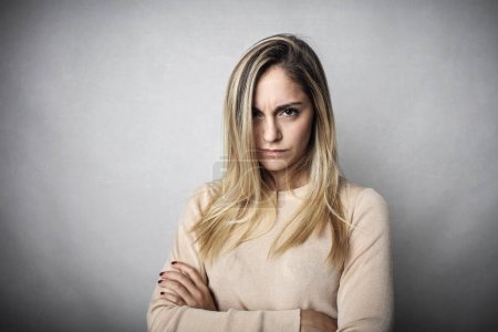 Portrait of a blonde girl with an angry expression