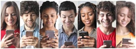 Photo for Portraits of boys and girl of various nationalities using a mobile phone - Royalty Free Image