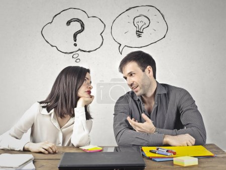 Caucasian man suggests an idea to a thoughtful woman