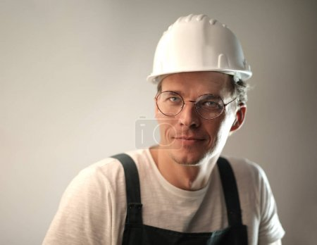 Caucasian worker with helmet and glasses