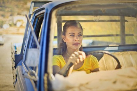 Girl driving a blue pick-up