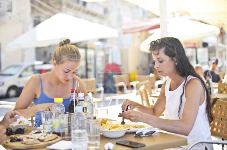 Two girls having lunch in a outdoor bar