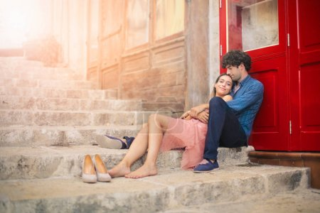 Couple relaxing on outdoor stairs