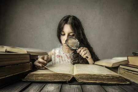 Girl studying from old books