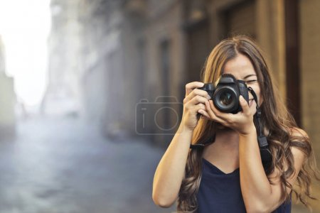 Girl with a camera outdoor