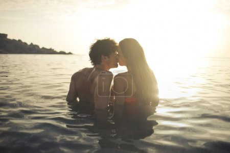 Couple kissing in the sea