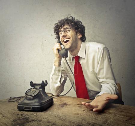Man using a vintage telephone