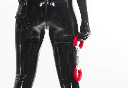 standing woman holding handcuffs