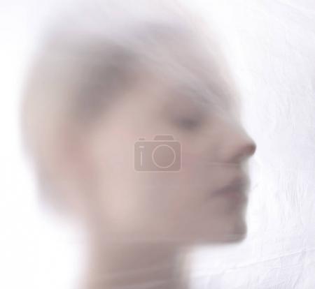 woman behind foil