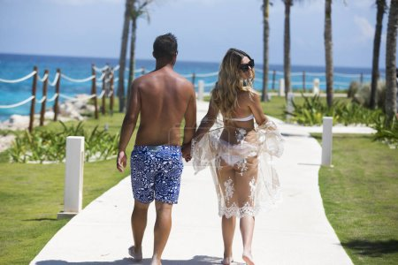 Young happy lovers on romantic travel honeymoon having fun on vacation summer holidays romance.