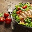 Fresh salad with chicken breast and tomato. Top vi...