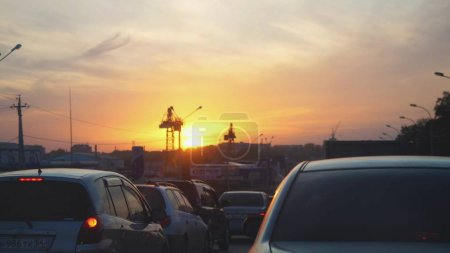 Russia, Novosibirsk, 17 september 2017. Car traffic and beauiful sunset on the road