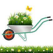 Garden Wheelbarrow And Grass With Flowers