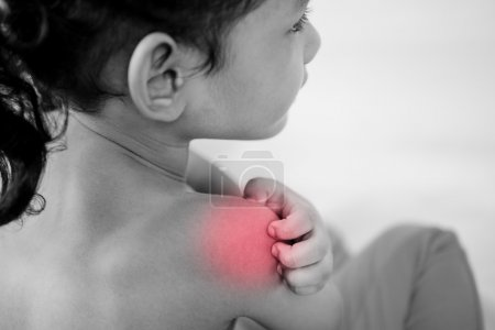 Health problem. asian young girl scratching her itchy shoulder