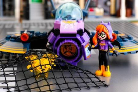 Lego Batgirl and her Batjet caught in net yellow Kryptomite