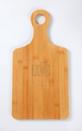 Photo for Wooden cutting board with handle on white background - Royalty Free Image