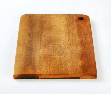 Photo for Wooden cutting board with hole on white background - Royalty Free Image