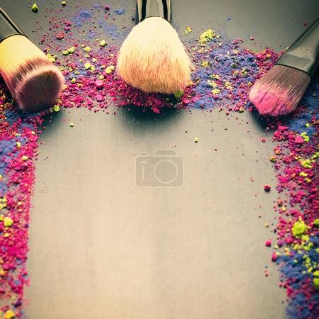 Makeup brushes on colorful background