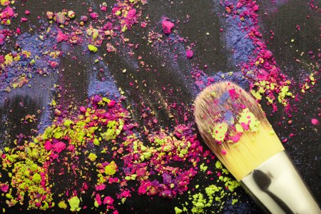 Top view of makeup brush on colorful background