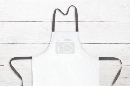 White apron on white wooden texture