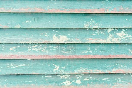 Old turquoise wooden fence