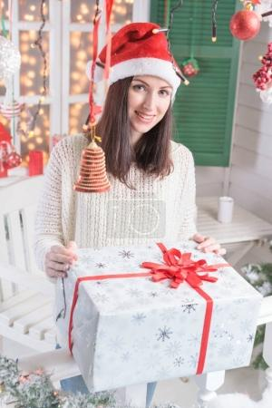 Happy woman with Christmas gift box