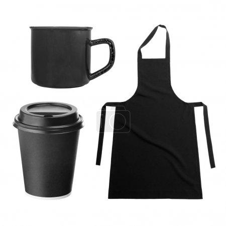Black apron and kitchen utensils