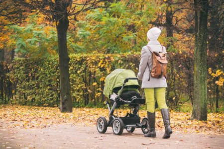 Mother walking in park with a stroller