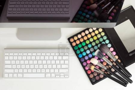 Makeup artist workplace with computer
