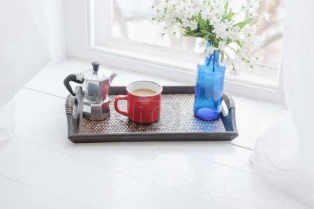 Morning coffee wooden tray on windowsill