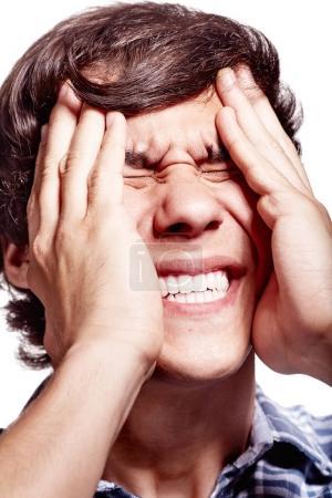Man with headache closeup