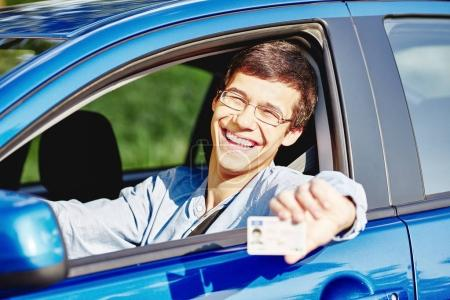 Guy in car with driving license