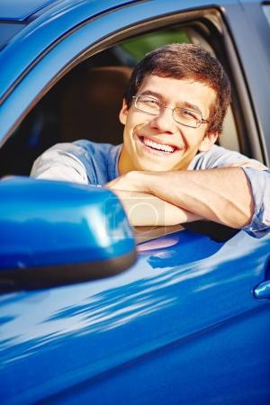 Smiling guy in car