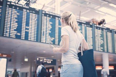 Girl near airline schedule