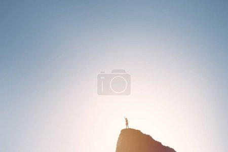 Winning girl on top of mountain