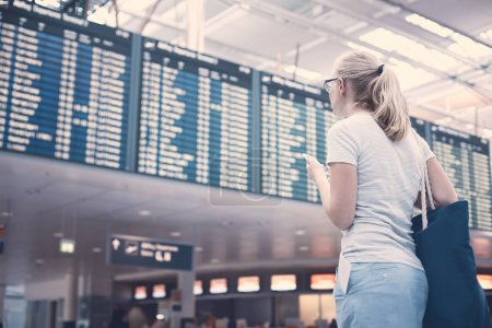 Girl near airline schedule