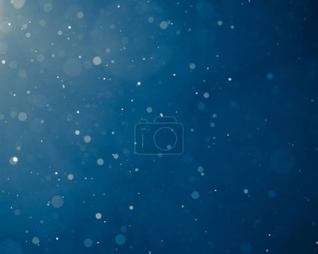 Photo for Blue light background with snowflakes particles - Royalty Free Image