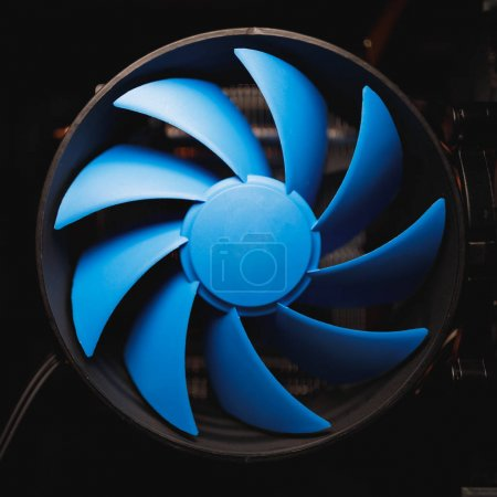 Photo for Blue cpu cooler inside PC case - Royalty Free Image