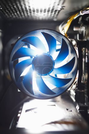 Photo for Blue cpu cooler inside PC case, shiny light background - Royalty Free Image