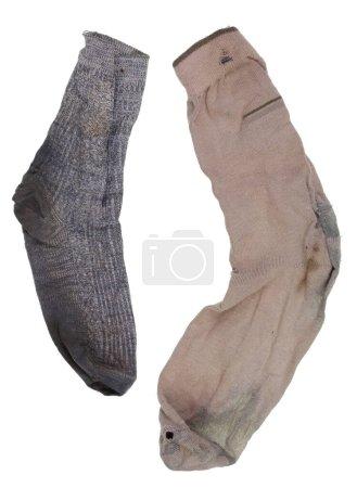 Photo pour Yin et Yang, concept masculin et féminin deux vieilles chaussettes puantes déchiquetées . - image libre de droit