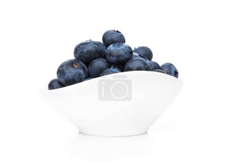 Photo for Fresh healthy organic blueberry in white bowl on white background - Royalty Free Image