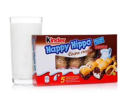 LONDON, UK - November 17, 2017: Kinder chocolate happy hippo and milk glass on white.Kinder bars are produced by Ferrero founded in 1946.
