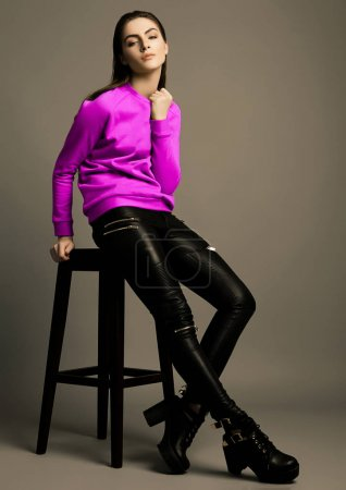Beautiful fashion model with violet purple jumper