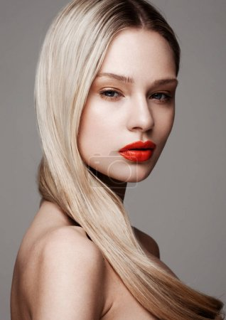 Photo for Beauty fashion model portrait with shiny blonde hairstyle with red lips on grey background - Royalty Free Image