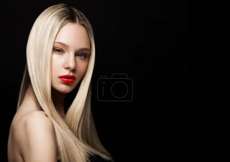 Photo for Beauty fashion model portrait with shiny blonde hairstyle with red lips on black background - Royalty Free Image