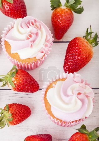 Photo for Cupcake muffin with strawberry cream dessert on wooden background with fresh strawberries - Royalty Free Image