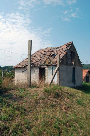 old house with broken roof